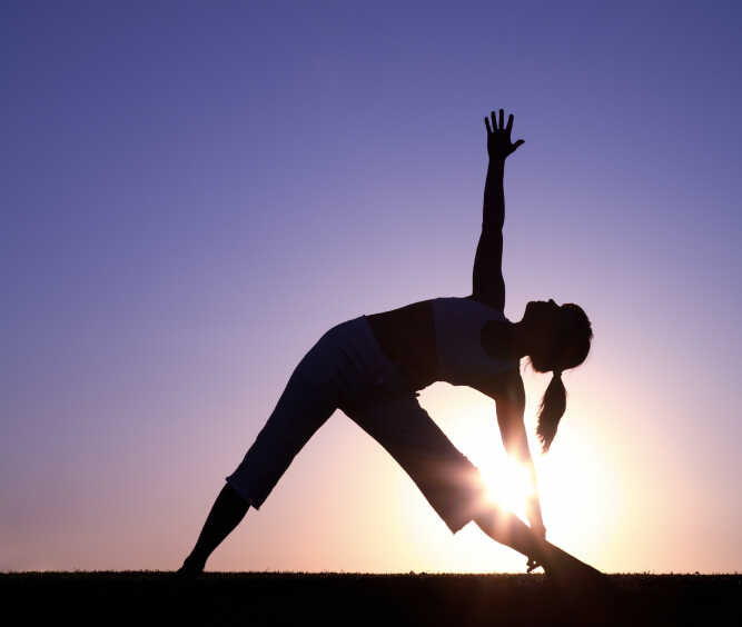Woman in a yoga pose.