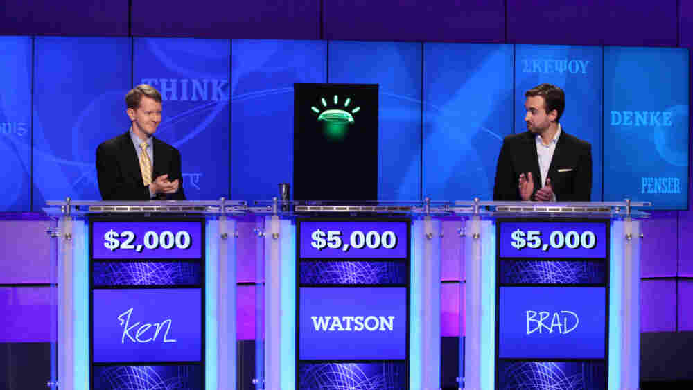 Jeopardy contestants Ken Jennings (left), Brad Rutter and a computer named Watson.