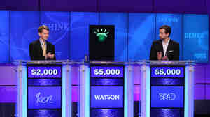 Jeopardy contestants Ken Jennings (left), Brad Rutter and a computer named Wat
