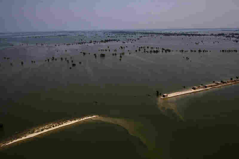 Land washed away by flooding is seen from a Pakistan Army helicopter during relief operations on September 13, 2010 in the village of Goza in Dadu district in Sindh province, Pakistan.