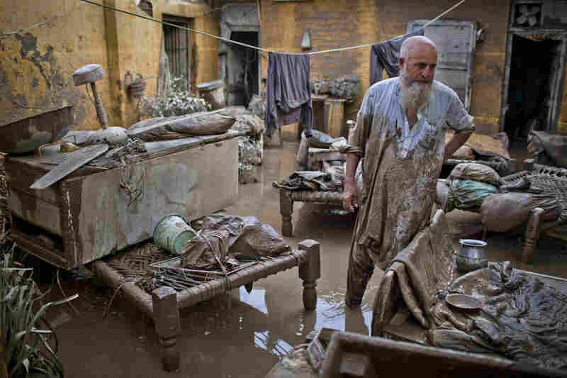 A Pakistani man surveys damage to his flood affected home on August 2, 2010 in Nowshera, Pakistan.