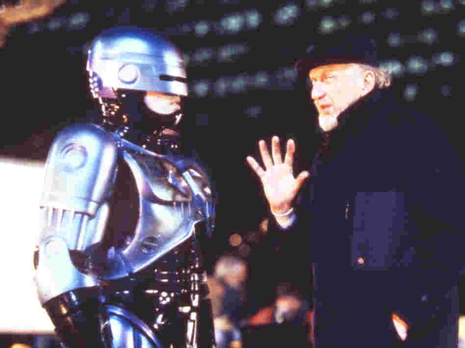 "Film director Irvin Kershner (right) and actor Peter Weller talk on the set of ""Robocop II."""