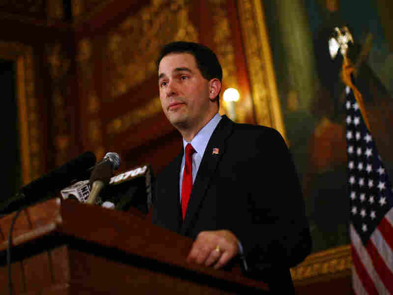 Republican Gov. Scott Walker speaks at a news conference inside the Wisconsin State Capitol on Monday.
