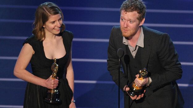 """Winners for Best Original Song Glen Hansard and Marketa Irglova accept the trophy for """"Falling Slowly"""" from Once."""