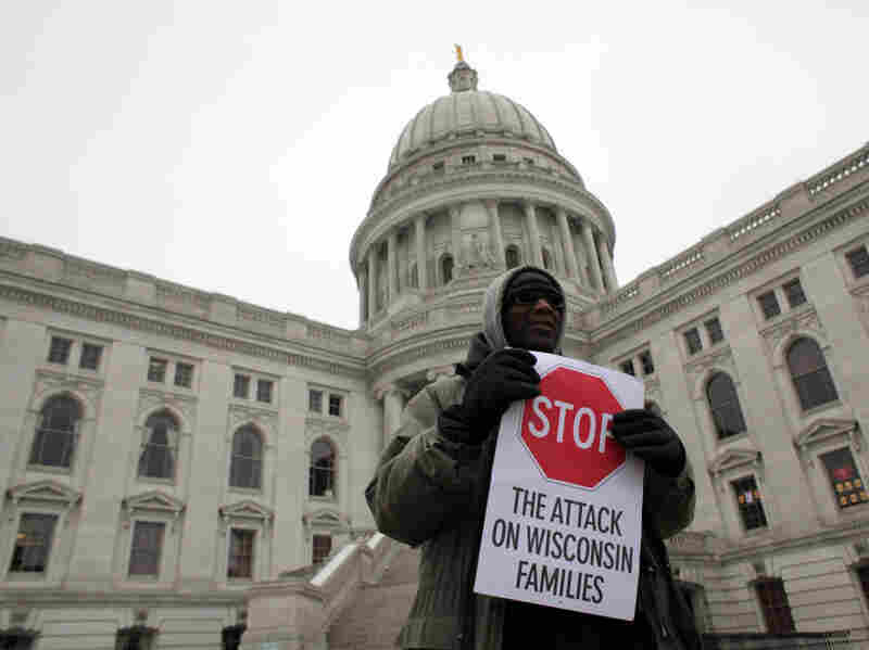 A protester rallied outside the Wisconsin State Capitol in Madison on Monday.