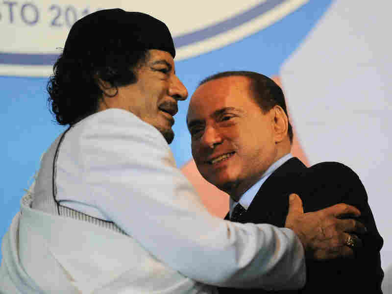 Libyan leader Moammar Gadhafi (left) embraces Italian Prime Mnister Silvio Berlusconi at the end of an equestrian show in Rome on Aug. 30.