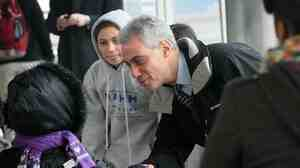 Rahm Emanuel, campaigning for mayor, greets Chicago commuters early this morning.  Polls close at 7 pm Central.