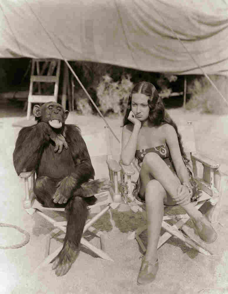 "Photo and caption originally published in May, 1938: ""Jiggs, Simian Movie Star, Rehearses With 'The Jungle Princess.'"" The setting, on a tropical island, is for a scene in the new Paramount picture, Jungle Love, starring Dorothy Lamour."""