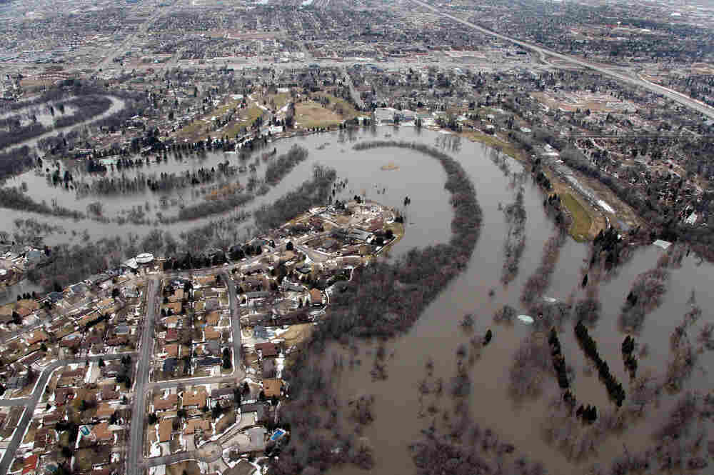 A file image shows the flooded Red River separating Moorhead, Minn., (right) from Fargo, March 2010. National Weather Service forecasters say that the chance for major flooding this year is above 90 percent.