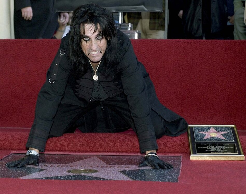Cooper touches his star, which was installed on the Hollywood Walk of Fame in 2003 in Los Angeles.  (AP)