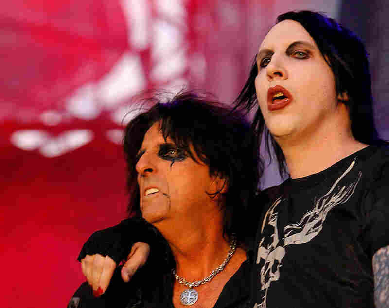 Marilyn Manson (right) performs with Cooper during a concert in Bucharest, Romania. Cooper's gory and scandalous stage act became fodder for later shock rockers like Manson and Rob Zombie.