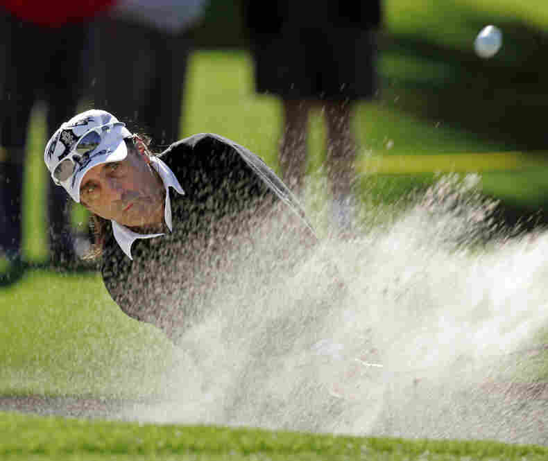 An avid golfer, Cooper regularly plays in tournaments and has cited the sport as having a big influence on his life, helping him overcome his alcoholism. Here, he blasts out of a bunker on the 10th hole during the second round of the Bob Hope Chrysler Classic golf tournament in 2008.