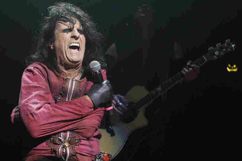"By the turn of the 21st century, Cooper was a household name and rock legend as he continued to tour and release albums. He is pictured performing his ""Halloween Night of Fear"" show at The Roundhouse in North London in 2010."
