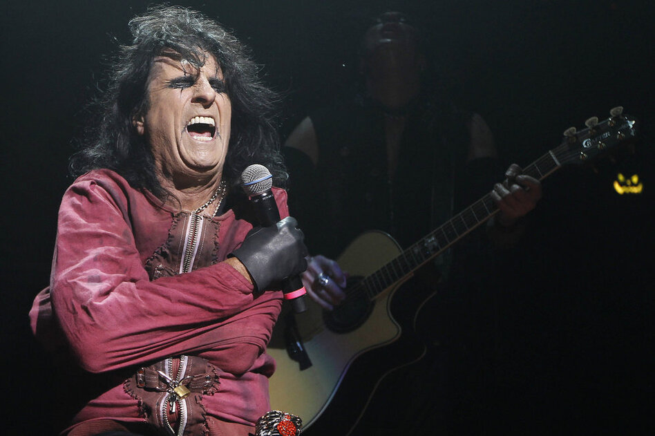 "By the turn of the 21st century, Cooper was a household name and rock legend as he continued to tour and release albums. He is pictured performing his ""Halloween Night of Fear"" show at The Roundhouse in North London in 2010.  (AP)"