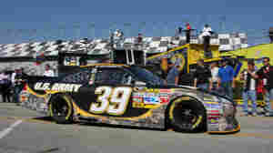 Sprint Cup Series driver Ryan Newman drives the Army's No. 39 NASCAR race car through the garage area at Daytona International Speedway on Feb. 18. Congress recently voted down an amendment that would have prevented the Army from spending $7 million to sponsor the car.