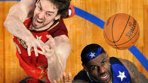 Pau Gasol, left, of the Los Angeles Lakers, and LeBron James, of the Miami Heat, fight for a rebound during the NBA All-Star Game Sunday. TV ratings for the game were the highest since 2003.