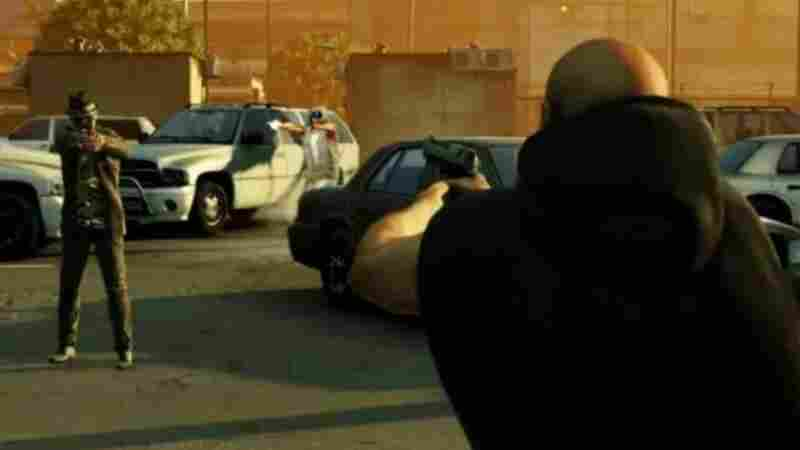"""A still from the video game """"Call of Juarez: The Cartel"""" shows two men aiming guns at each other. Critics say the video game dehumanizes the people who have been killed in the Juarez drug wars."""