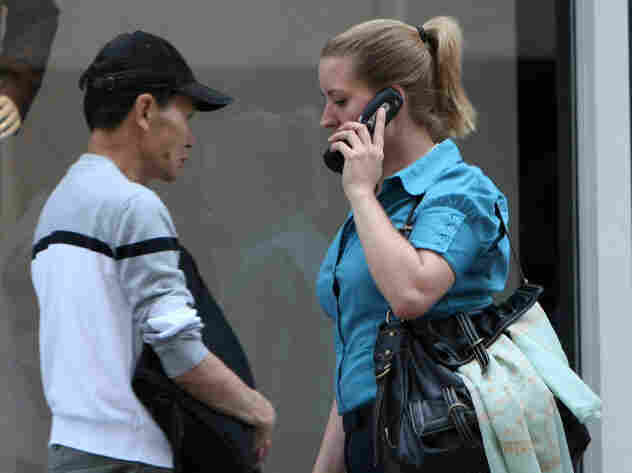 A new study finds that radio waves from a cell phone can affect the metabolism of brain cells, though there is no evidence that the effect is harmful. Here, a pedestrian talks on her phone on a street in San Francisco.