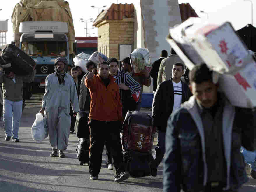 Many Egyptians who had been in Libya fed across the nations' boarder today (Feb. 22, 2011).