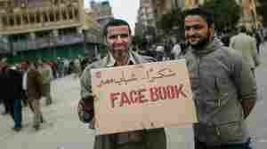 Feb. 4: Anti-government protesters held a sign referencing the Facebook social networking website that was important in organizing protesters in Tahrir Square.
