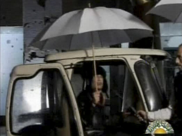 In this video image broadcast on Libyan state television early Tuesday, leader Moammar Gadhafi is shown. Gadhafi appeared for less than a minute on state television and made brief remarks to say he was in the capital Tripoli and deny rumors he had to fled to Venezuela amid the unrest sweeping his country.