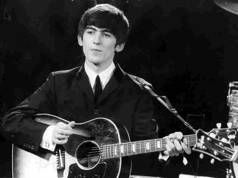 George Harrison performs with The Beatles in 1963.