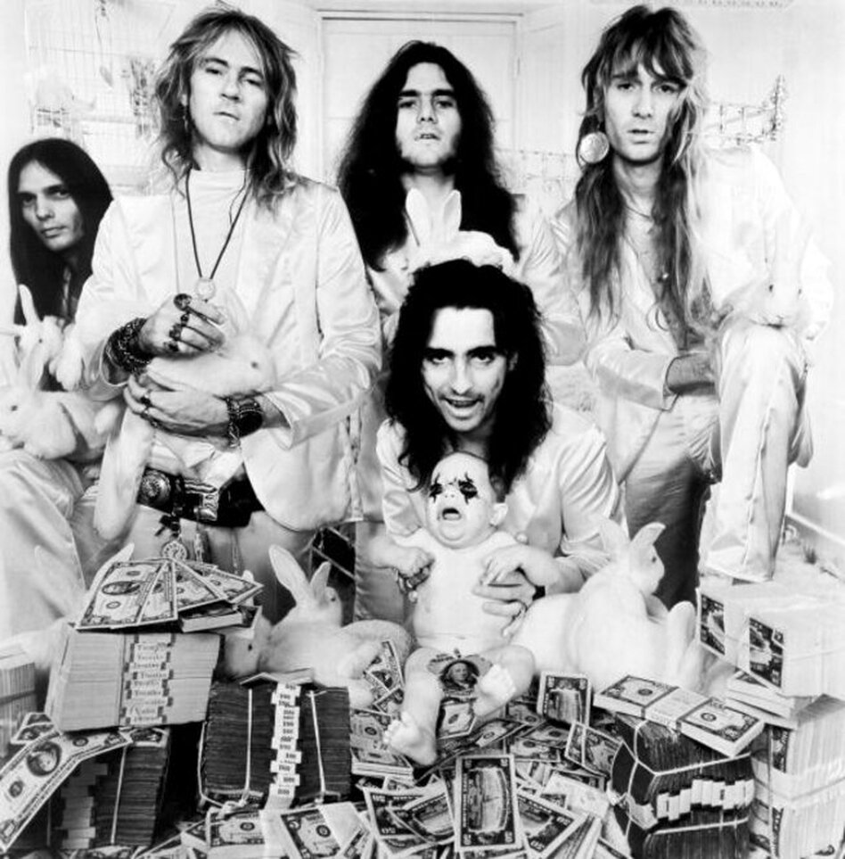 "Born in 1948, Cooper (originally named Vincent Furnier) was raised in Phoenix. Inspired by his high school band, Alice Cooper formed in the mid-1960s. The Alice Cooper band went against the grain, creating a persona of ""the rock villain""; by 1971, the group had a record deal with Warner Bros. Records and a top-selling album called Love it to Death.  (Getty Images)"