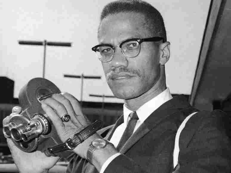 Civil rights leader Malcolm X holds an 8mm movie camera in London July 1964, shortly after breaking his affiliation with the Nation of Islam.
