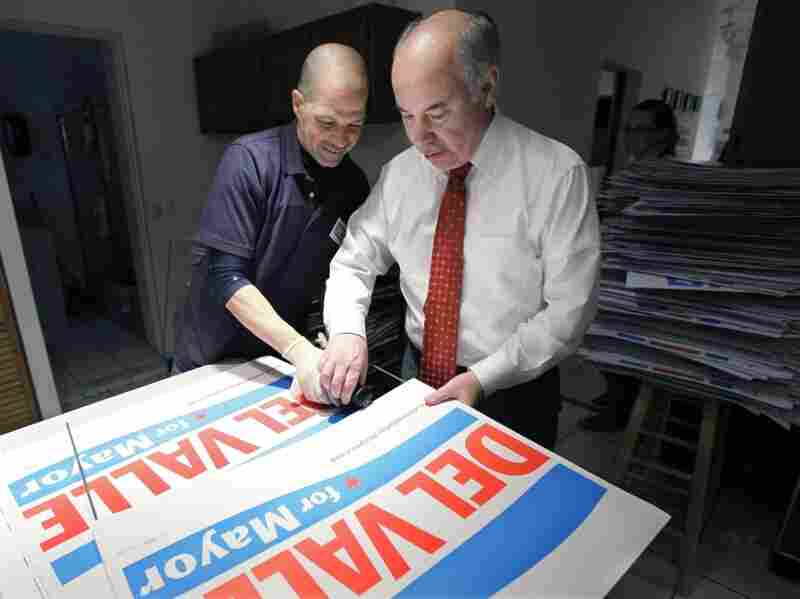 Chicago mayoral candidate Miguel del Valle assembles campaign signs with volunteer Israel Martinez at campaign headquarters Monday.