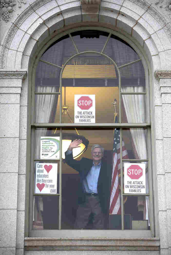 On Feb. 16, Democratic Wisconsin Sen. Mark Miller waved to protesters marching at the Capitol against Gov. Scott Walker's plan to eliminate collective bargaining rights for many state workers. Miller and his fellow Senate Democrats left the state the next day to stall a vote on the plan.