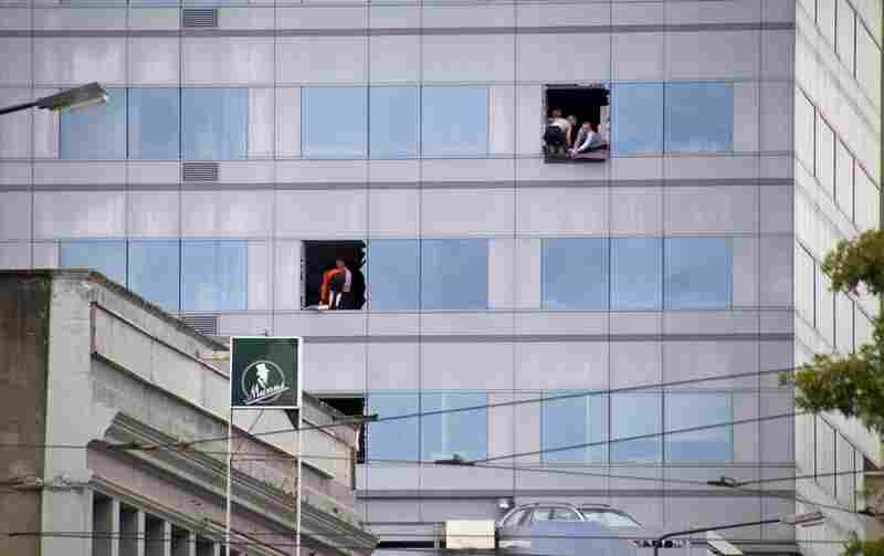 People trapped in a high-rise building in central Christchurch broke windows as they waited to be rescued.