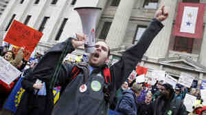 Jason Petroff leads cheers at a protest outside Ohio's Statehouse, Tuesday, Feb. 22, 2011, in Columbus.