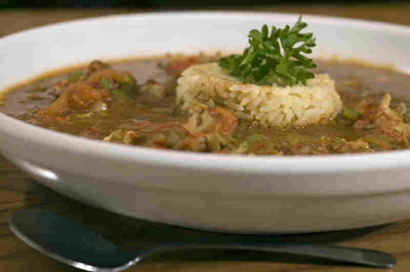 A bowl of gumbo with rice.