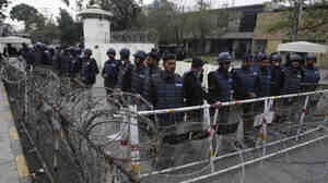 Pakistani police officers surround the U.S. Consulate during rallies on Feb. 18 condemning Raymond Davis, a U.S. Embassy employee who shot dead two Pakistanis in Lahore in January.