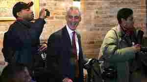 Mayoral candidate Rahm Emanuel leaves Chicago's Home of Chicken and Waffles restaurant following a campaign stop and lunch Monday. He is the front-runner among the six candidates.