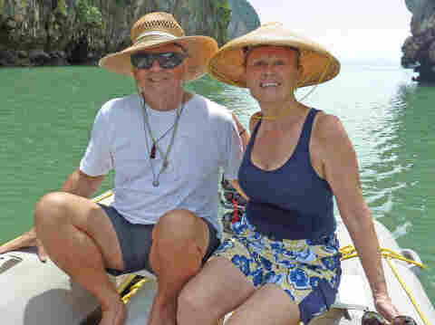 Scott and Jean Adam  pose in an undated photo posted on their website, svquest.com, which promotes  and documents their 'around-the-world' voyage and other travels since 2002.