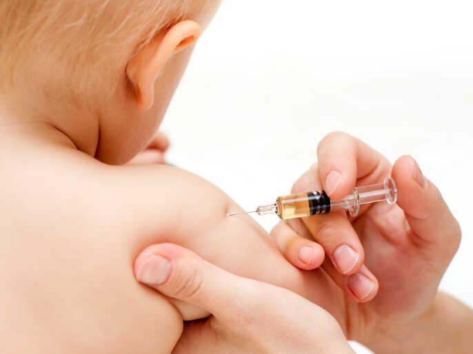 A child gets immunized.