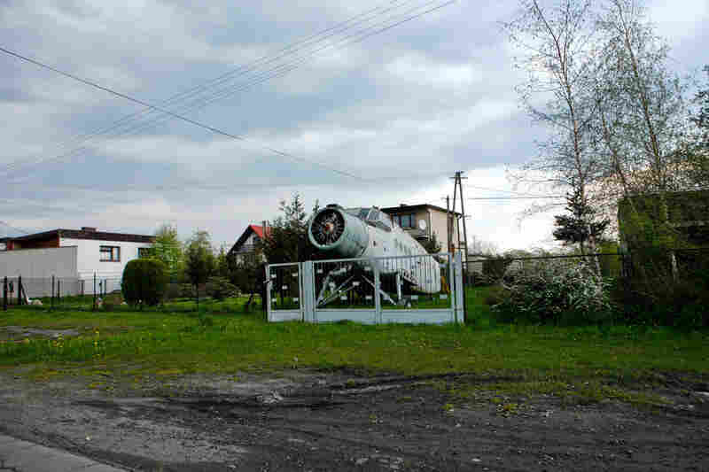 The carcass of a communist-era plane decays in the front lawn of home near Oswiecim.
