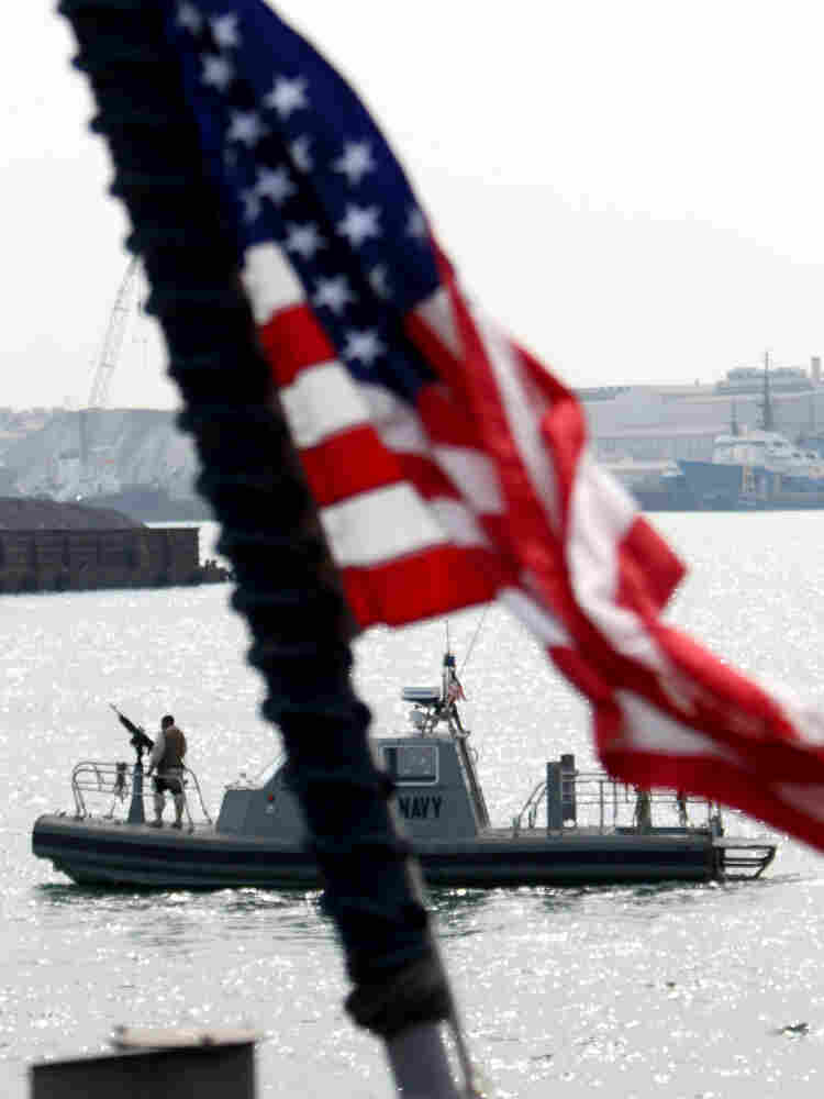 In this photo taken Jan. 20, 2010, a U.S. Navy vessel seen from the deck of a U.S. ship docked in Manama, Bahrain, patrols the harbor area of the tiny island nation. Bahrain is the home base of the Navy's 5th Fleet and has a strategic location in the Persian Gulf.