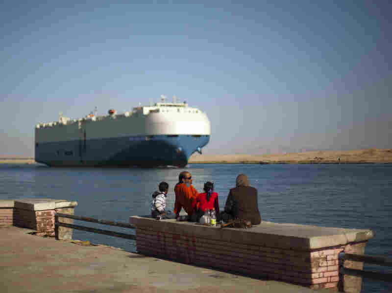 A cargo ship transits the Suez Canal en route from the Mediterranean Sea to the Gulf of Suez at the city of Suez, Egypt, on Feb. 2. Egypt controls the canal, which is vital to U.S. interests.