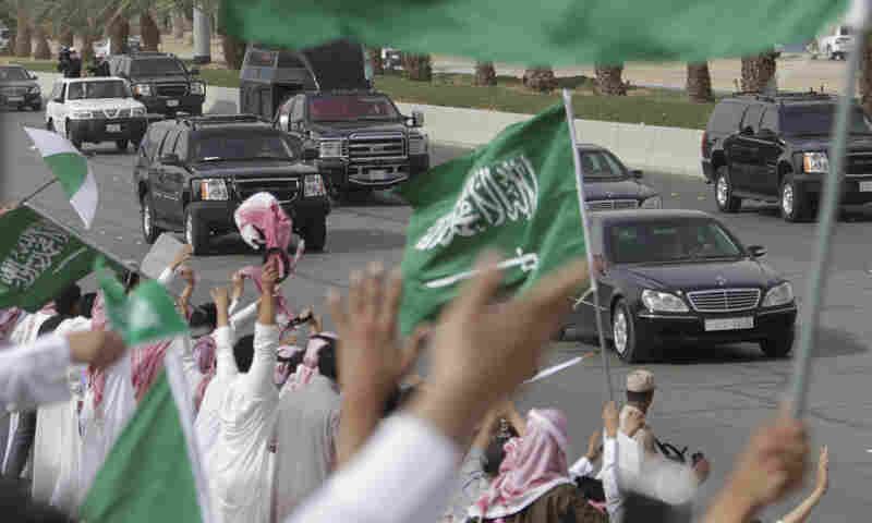 Saudis wave and cheer as the convoy of King Abdullah of Saudi Arabia passes through the streets of Riyadh on Wednesday. As the king returns from three months of medical treatments, he faces increasing demands for political reform.