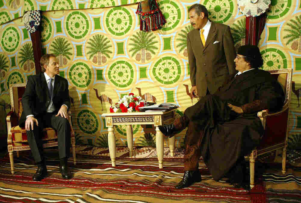 Then-British Prime Minister Tony Blair sitting with Libyan leader Moammar Gadhafi in 2004 in Tripoli.
