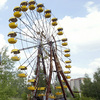 An abandoned ferris wheel and carousel in the amusement park of the ghost town of Prypyat, adjacent to the Chernobyl nuclear plant.