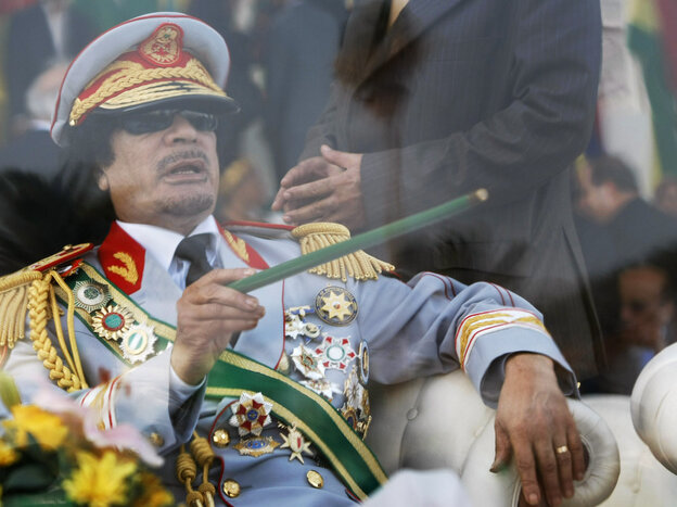 Sept. 1, 2009: Libyan leader Moammar Gadhafi gestures with a gr