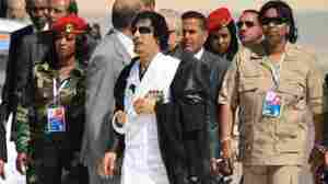 Libyan Leader Moammar Gadhafi has created an all-woman bodyguard unit for himself. Here, they're with him in Italy in 2009.