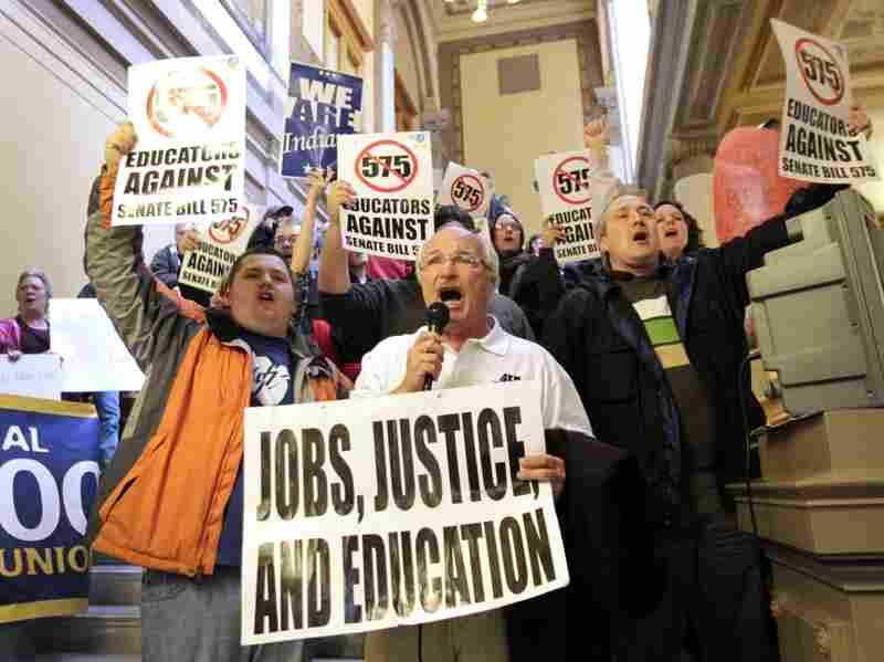 Rick Muir, president of the Indiana Federation  of Teachers, chants with other protesters at the statehouse in  Indianapolis on Feb. 23. Teacher groups are protesting Indiana Senate bill 575 which would remove some collective bargaining rights for teachers.