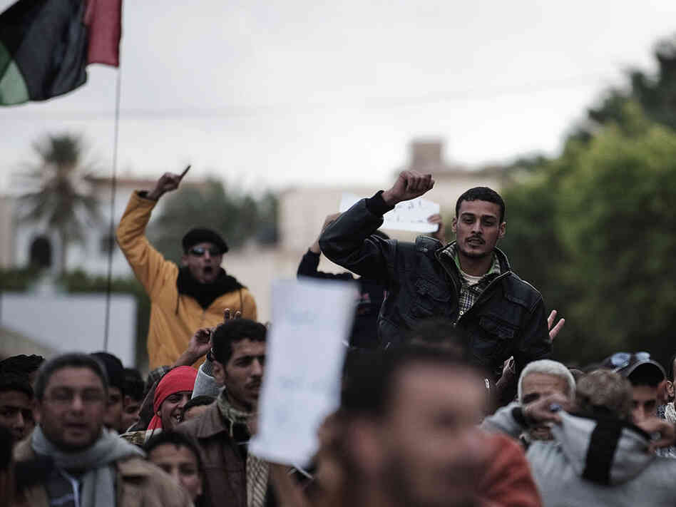 Libyan  protesters shout anti-Gadhafi slogans during a demonstration in the eastern  Libyan town of Derna on Wednesday.