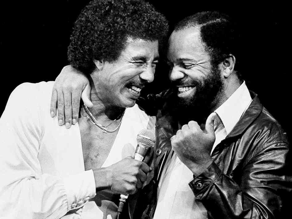 Smokey Robinson, left, is joined by friend and fellow entertainer Berry Gordy at the Greek Theater in 1981.