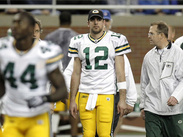 Green Bay quarterback Aaron Rodgers walks off the field