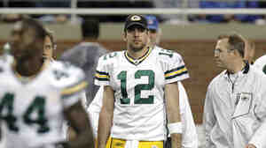 Green Bay quarterback Aaron Rodgers walks off the field at halftime after leaving a game against Detroit with a concussion, Dec. 12, 2010.